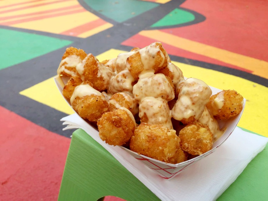Yuuum, tater tots drenched in beer cheese!